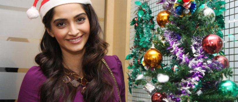 Bollywood actress Sonam Kapoor Celebrating Christmas and Posing with Christmas theme.